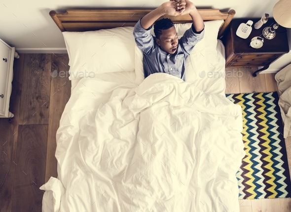 Man waking up in the morning - Stock Photo - Images