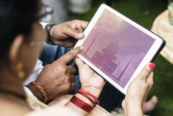 Indian family interested in life insurance - Stock Photo - Images