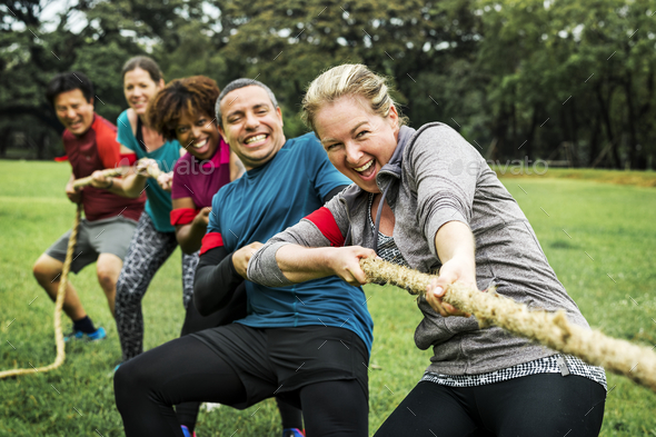 Team competing in tug of war - Stock Photo - Images