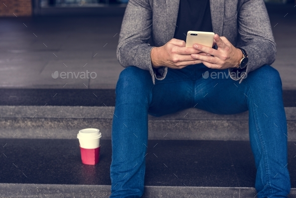 Man using his mobile phone - Stock Photo - Images