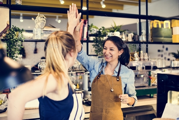 Women give a high five to each other - Stock Photo - Images
