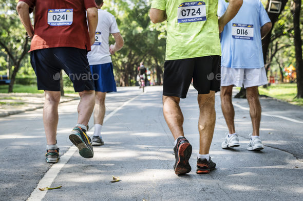 Mature runners running in a race - Stock Photo - Images