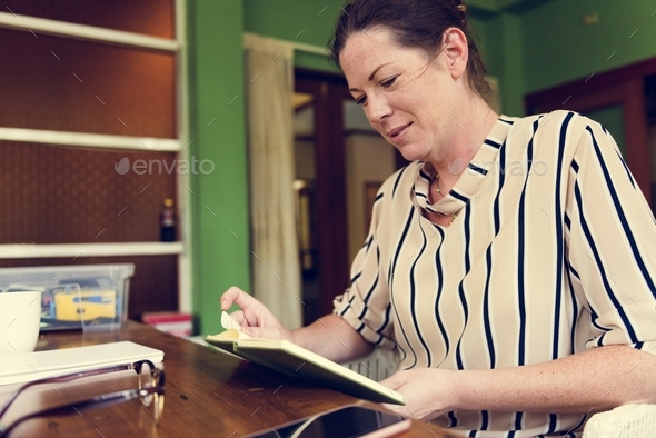 Caucasian woman reading a book - Stock Photo - Images
