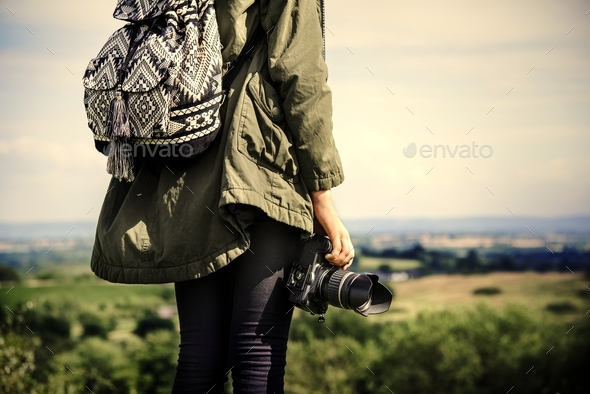 Woman with camera in the nature - Stock Photo - Images