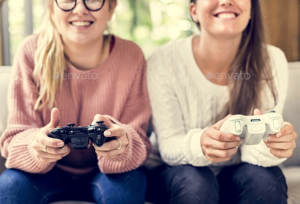 Women playing video game together - Stock Photo - Images