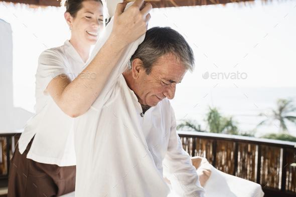 Senior man having a massage - Stock Photo - Images