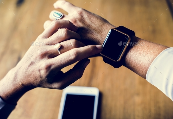 Hands setting a electronic smart watch - Stock Photo - Images