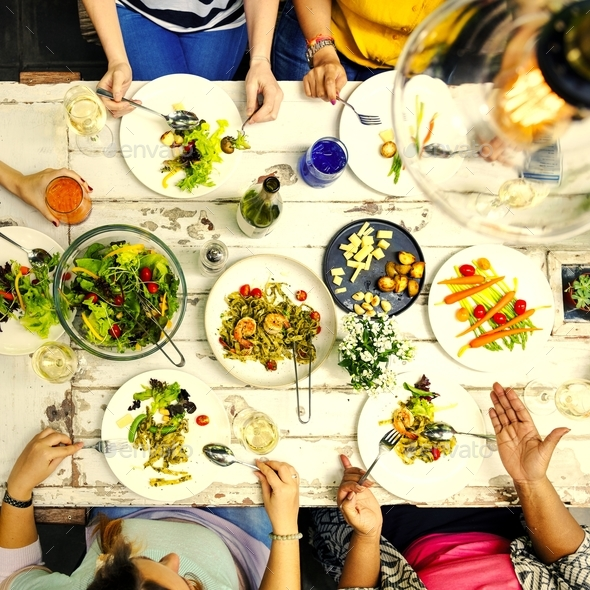 Woman having a dinner party - Stock Photo - Images