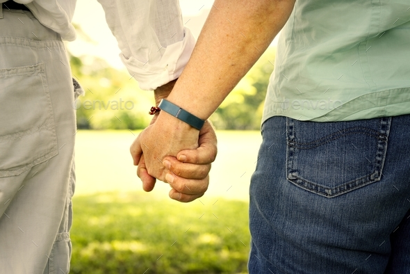 Senior couple holding hands - Stock Photo - Images