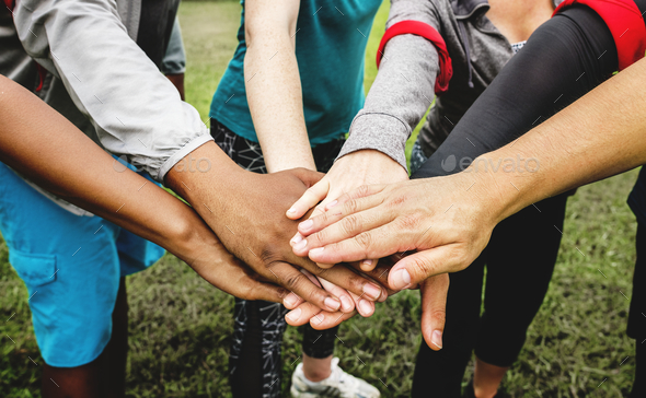 Diverse people stacking their hands - Stock Photo - Images