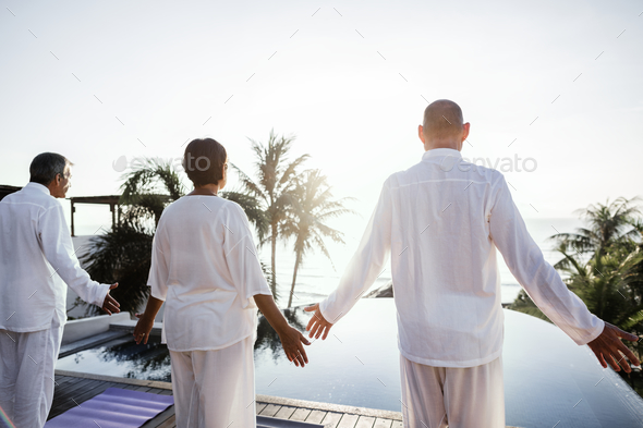Seniors practicing yoga - Stock Photo - Images