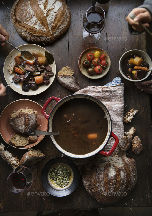 Dinner table with a meat stew food photography recipe idea - Stock Photo - Images