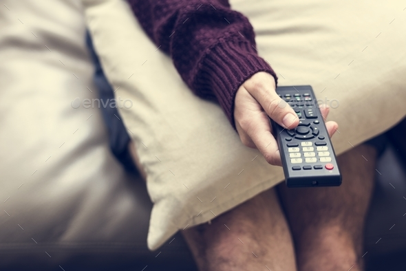 Hand holding television remote control - Stock Photo - Images