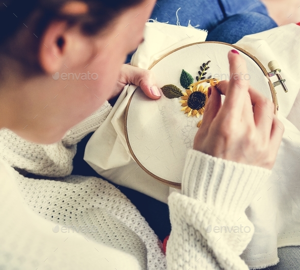 Young girl doing some needlework - Stock Photo - Images