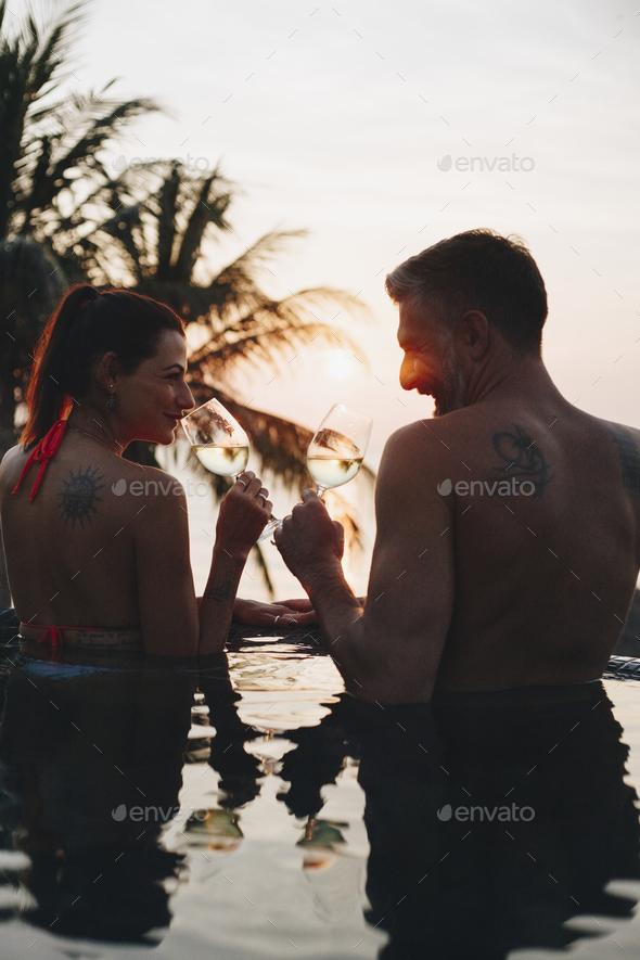 Couple enjoying a romantic sunset - Stock Photo - Images