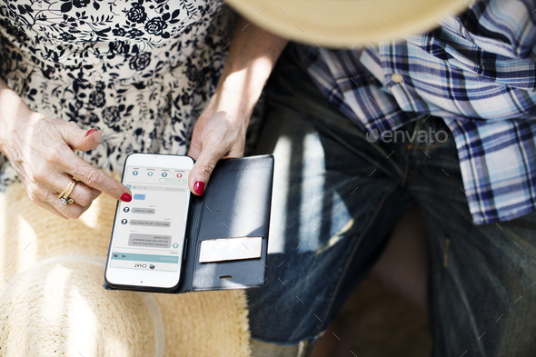Senior woman using her mobile - Stock Photo - Images