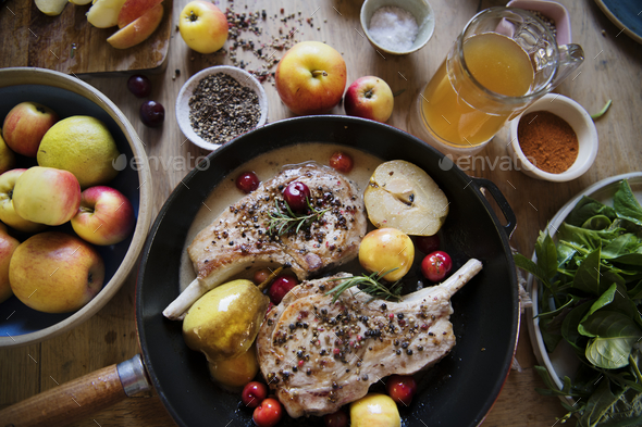 Pork chop with apples food photography recipe idea - Stock Photo - Images