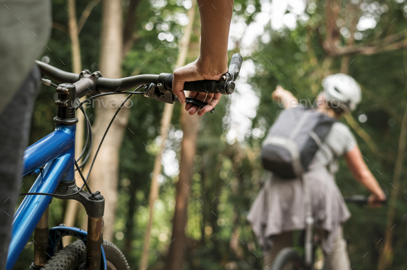Group of diverse cyclist in the forest - Stock Photo - Images
