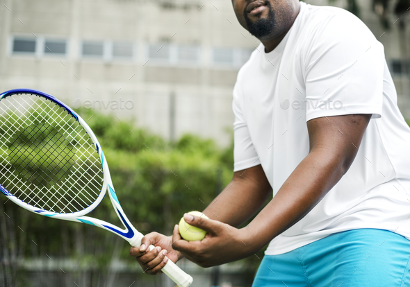 Player getting ready for a serve in tennis - Stock Photo - Images