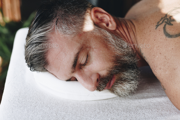 Man relaxing with a spa treatment - Stock Photo - Images