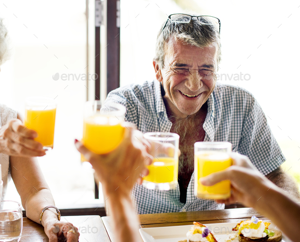 Senior man having breakfast - Stock Photo - Images