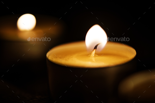 Candles glowing in the dark - Stock Photo - Images