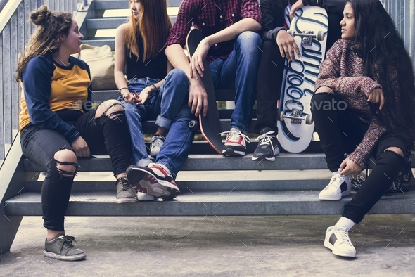 Group of school friends outdoors lifestyle and street urban style concept - Stock Photo - Images