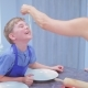 Culinary Woman Gives a Small Boy in the Kitchen To Sample a Pasta - VideoHive Item for Sale
