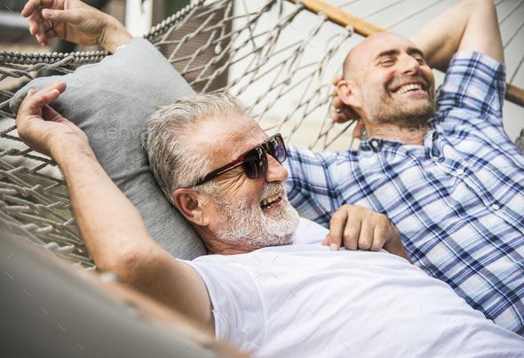Senior men chilling on a hammock - Stock Photo - Images