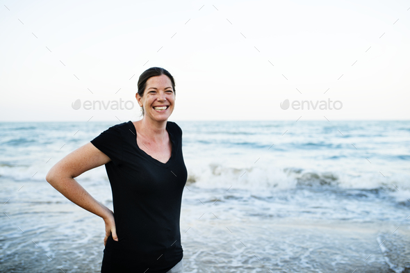 Caucasian woman on the beach - Stock Photo - Images