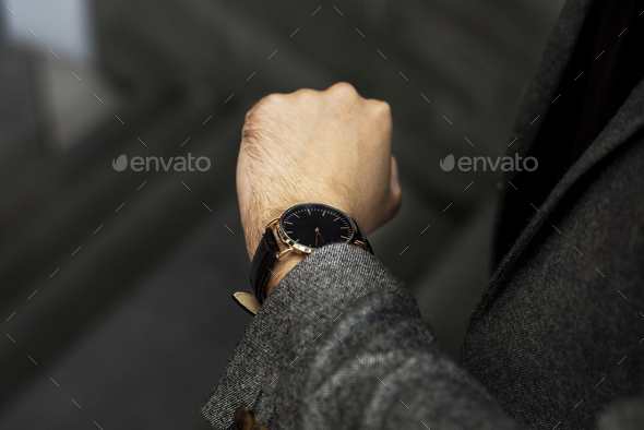 Man looking at his watch - Stock Photo - Images