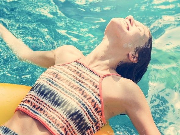 Girl cooling down in a swimming pool - Stock Photo - Images