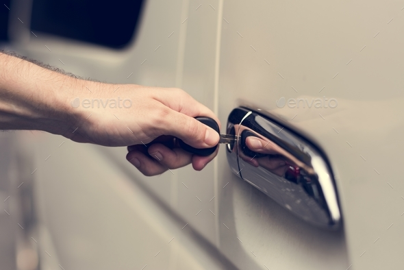 Unlocking a car door with a key - Stock Photo - Images
