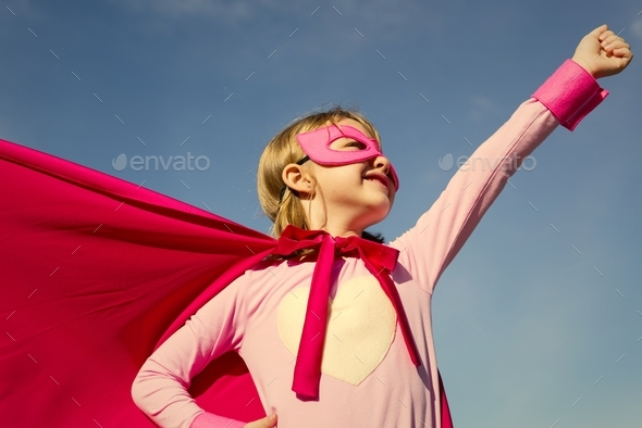 Little cute girl playing superhero - Stock Photo - Images