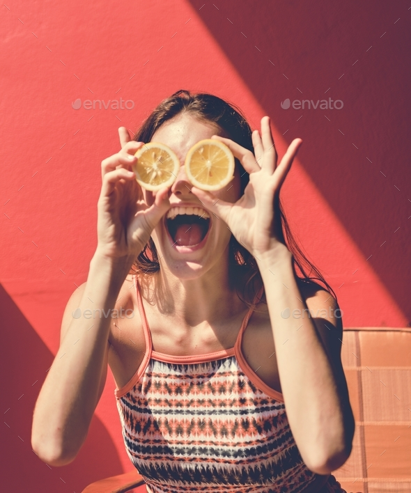 Happy cute girl with oranges - Stock Photo - Images