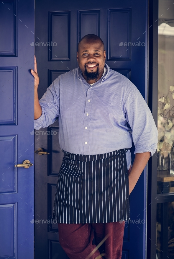 A cheerful small business owner - Stock Photo - Images