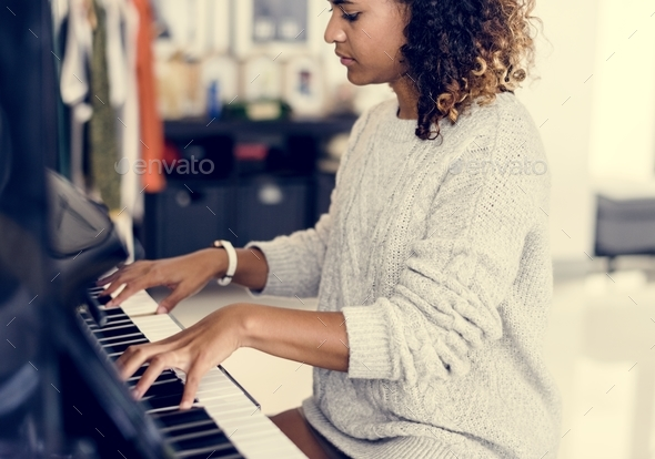 Woman playing on a piano - Stock Photo - Images