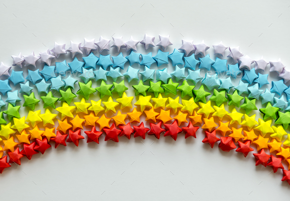 Colorful orgami stars forming a rainbow background - Stock Photo - Images