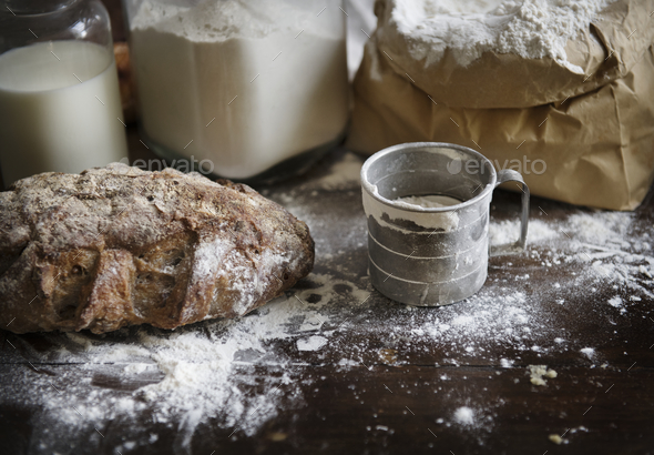 Flour and bread on a messy kitchen top - Stock Photo - Images
