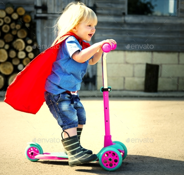 Happy little boy playing superhero with imagination - Stock Photo - Images