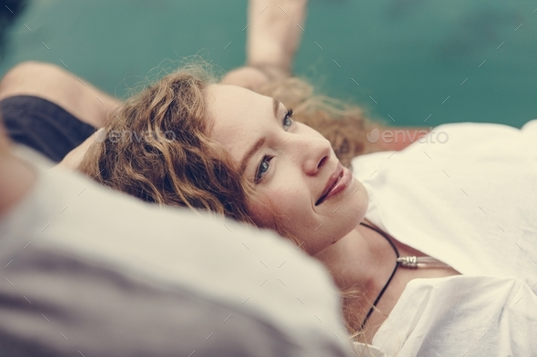 Woman relaxing in her boyfriends lap - Stock Photo - Images