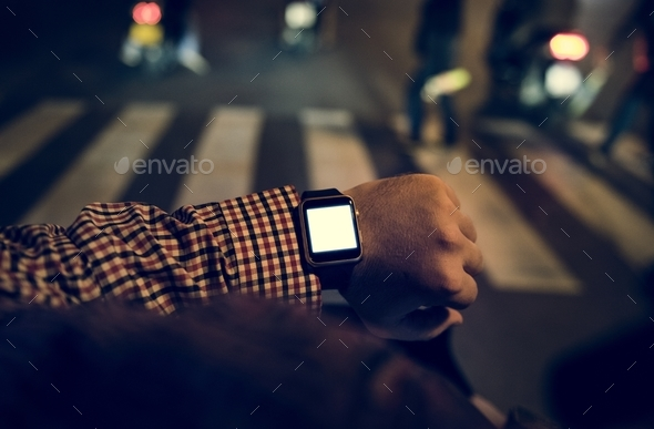 Arm with digital wrist watch at night time - Stock Photo - Images