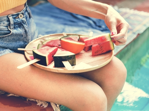 Caucasian woman eating watermelon in summertime - Stock Photo - Images