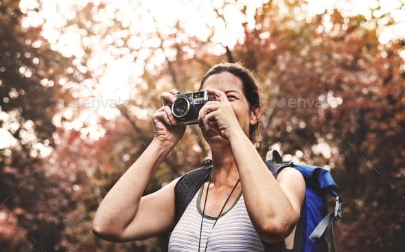 Woman with an analog camera - Stock Photo - Images