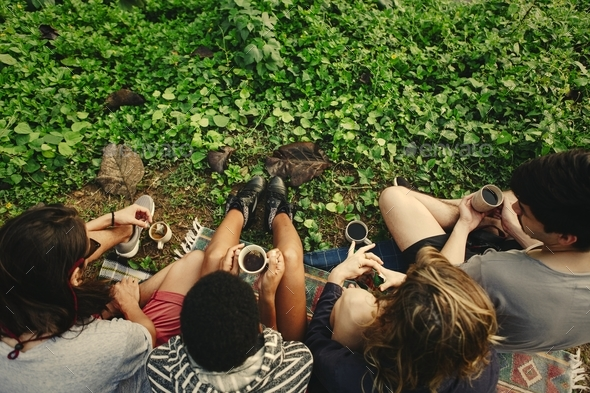 Friends having coffee in the nature - Stock Photo - Images