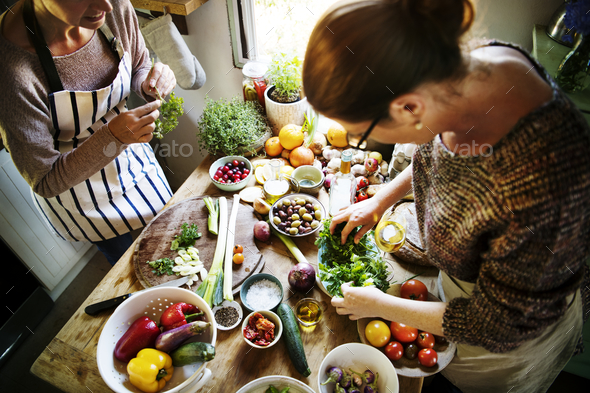 Women preparing a dinner in the kitchen - Stock Photo - Images