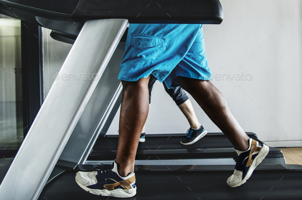 Man running on a treadmill - Stock Photo - Images
