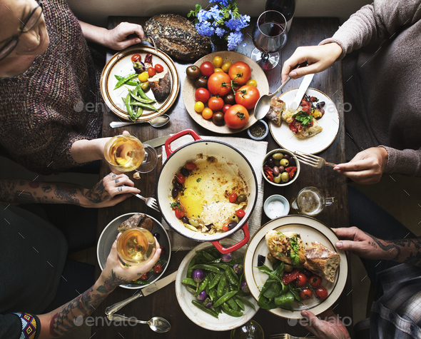 Group of adults at a dinner party - Stock Photo - Images
