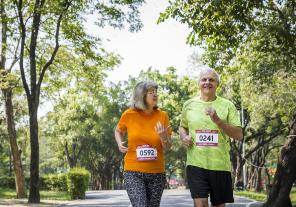 Couple running together in a race - Stock Photo - Images