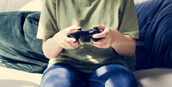 Woman playing video game alone - Stock Photo - Images